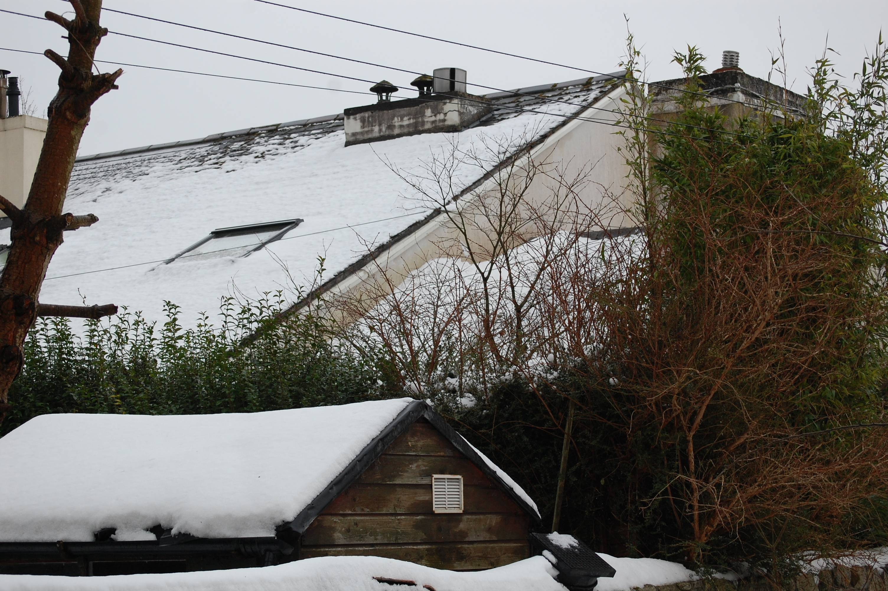 Snow drifts accumulate on roofs causing additional loads