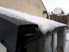 Gutters filled with snow and ice can overflow when snow melts