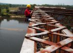 Man working on complex steelwork. Structural Engineers create the skeletons of complex buildings